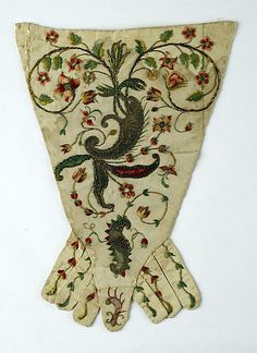 Stomacher Date: 1700–1750 Culture: probably French Medium: silk, gold Dimensions: Length: 12 1/2 in. (31.8 cm) Credit Line: Purchase, Irene Lewisohn Bequest, 1958 Accession Number: C.I.58.29