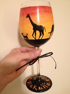 disney lion king wine glass i painted for my best friend-- sunrise with silhouettes of all of the characters and other african animals
