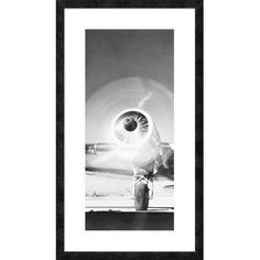 """Global Gallery 'Triptych - Front View of Passenger Airplane - Left Panel' Framed Graphic Art Size: 38"""" H x 21.2"""" W x 1.5"""" D"""