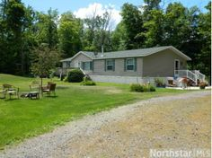 Dont miss this home! Beautiful 1+acre corner lot w/mature landscaping. Stay year round or use as your cabin/vacation getaway. New boat launch nearby. New well in 2013. Oversized bedrooms and gas fireplace for cold nights.