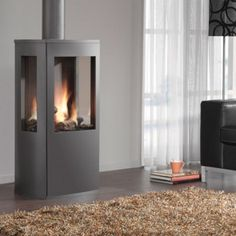The DRU Trio freestanding gas fire combines the nostalgia of a rustic gas stove … – Freestanding fireplace wood burning Gas Fire Stove, Pellet Stove, Gas Fires, Freestanding Fireplace, Fireplace Hearth, Fireplaces, Small Space Living, Living Spaces, Log Burner