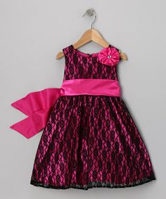 Any little lady can dress up easily in this fancy frock thanks to a back zipper and ribbon tie. Plus tulle-laden lining creates a cloud of poufiness that's sure to impress any classy crowd.
