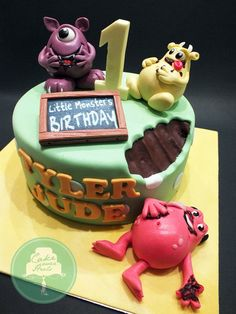 Little Monsters' Birthday cake idea-- I like the bite taken out of the cake by the monster