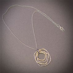 Hammered sterling silver rings necklace