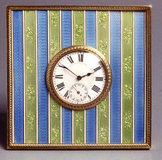A Cartier triangular enameled silver-gilt table clock, with a panel of green guilloché enamel decorated with alternating gilt vertical lines and bands of husks.