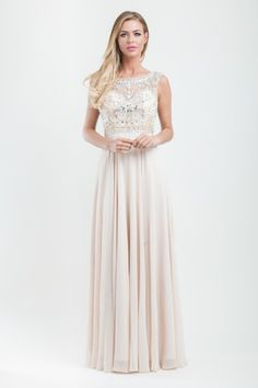 ith envy. The high collar neckline and cap sleeves are embellished with silver sequins and stones that perfectly catch the dance floor lights. More detailing runs along the bodice of the top for a fully embellished look. Luxurious chiffon billows from the waist down to create a stunning but dramatic effect.