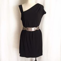 """Essentials by A.B.S. Black Dress Sexy tunic style dress from Allen Schwartz's Essentials by A.B.S. Asymmetric neckline with two different shoulder styles. Looks great worn loose or accessorized with your favorite belt as shown! Fully lined. 92% polyester; 8% spandex. Lining is 100% polyester. Machine wash but dry clean recommended. Size Medium. Bust: 19.5"""".  Hip: 19.5"""".  Length: 33.5"""". EUC. Belts not included. Thanks for looking! Essentials by A.B.S. Dresses"""