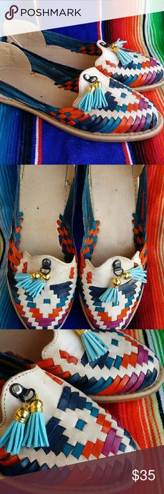 Colorful Handmade Mexican Leather Huaraches 9 Cute pair of leather sandals  Traditional Mexican style Handmade in my husband's hometown Sahuayo  The main shoes is an ivory with varying colors woven throughout, blue tassel detail  Leather conforms to your foot with wear Size 9  I'm happy to help with any sizing questions  *please note- color variations are due to the way the leather absorbs the dye, it can vary but is apart of its unique charm Shoes Sandals
