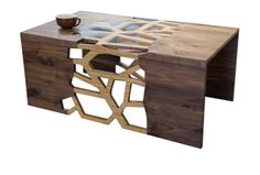 Handmade Organic Wood Mosaic Coffee Table from Dot & Bo. Its open center adds geometric visual interest, and the plexiglass inserts can be removed or added to create a solid surface to hold up a decorative centerpiece.