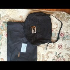 """Gorgeous Authentic FENDI purse This is a gorgeous Authentic FENDI Borsa Passa Zuccino in Nero.  Has iconic """"F"""" print all over material. Leather handle. One interior zippered pocket. Gently used beauty Comes with FENDI dust bag  measurements 10 inches tall 12 inches wide 5 inches deep NO trades please FENDI Bags Hobos"""