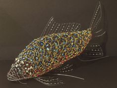 Wire fish to sit on top of the aquarium