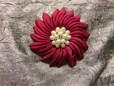 Vintage look Raspberry grosgrain ribbon flower, 4 in. Diameter.  Wear alone as brooch or add to a scarf, hat, or hair.
