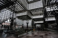 Steel as roof. Also, with the strength of steel, the roof is transparent and open, allowing more daylight to come in the conference center design by I.M.Pei.