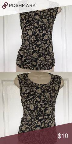 Sleeveless black blouse with cream floral design Good condition. Easy wash and wear. Tops Blouses