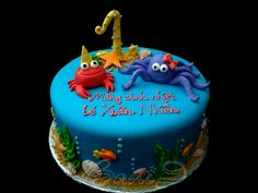 "9"" vanilla cake with pina colada filling , fondant decoration with Under the sea theme.  1st birthday, crab, octopus, sea theme, ocean cake, fish"