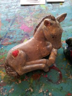 a horse that looks ready to run painted at Faux Arts in Marlborough, in a ceramic drop in
