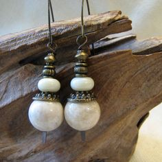 brass and off white stacked earrings by themoonbeam on Etsy https://www.etsy.com/listing/548122806/brass-and-off-white-stacked-earrings