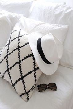 Homevialaura | Chhatwal & Jonsson | Ikat cushion | panama hat | Ray-Ban Cats 1000