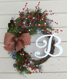 Monogrammed Christmas Wreath! Snow covered evergreen branches, pinecones, red and white berries, and a red chevron bow adorned with a Jingle Bell!
