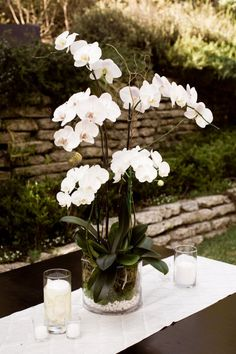 style me pretty - real wedding - usa - california - laguna beach wedding - the bride's brother's home - reception decor - centerpiece - phalaenopsis orchids