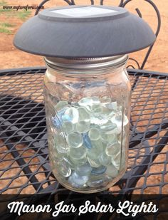Mason jar lighting using the tops of solar lights and a few gems to reflect the soft lighting for your patio or yard    http://www.myturnforus.com/2015/05/mason-jar-solar-lights.html