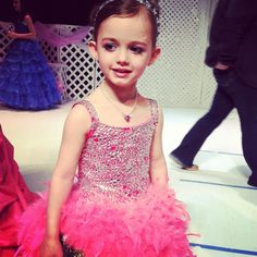Bright pink pageant dress with feather skirt. Fabulousness!!