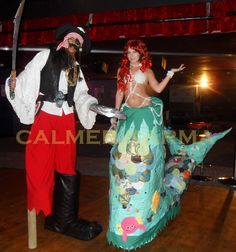 Mermaid and Pirate Stilts for Under the Sea and All at Sea themed events inc… Uk Pirate, Pirate Theme, London Birmingham, Party Entertainment, Pirates Of The Caribbean, Under The Sea, Corporate Events, Brighton, Wales