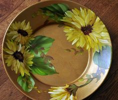 A paisley and script background brings charming vintage style to the French Sunflower dinner plate set. Decorated with a sunny floral motif these u2026 & A paisley and script background brings charming vintage style to the ...