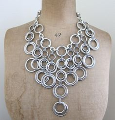 Vintage chunky silver ring and chain necklace with leather thonging. $29.00, via Etsy.