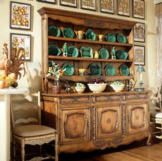 French hutch with a majolica collection and fruit prints.  This would work in My Traditional Home, Patti Montgomery.