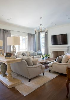 Family room, neutral colors, English roll arm sofa