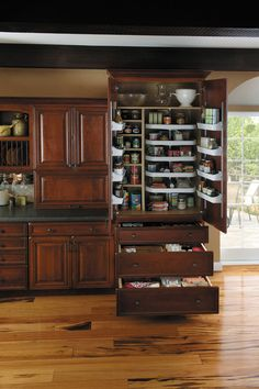 StarMark Cabinetry Super Chef Pantry with Drawers. Five adjustable turntables, four adjustable door mount shelves and three drawers in lower portion.