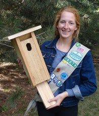For Katie's Gold Award Project, she organized volunteers to build houses for bluebirds, who are often crowded out of their natural habitat by house sparrows.