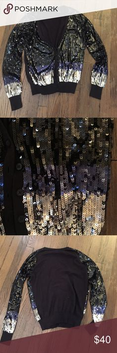 Sequined cardigan Gorgeous tri-color sequin cardigan.  Black sequins cascades into blue, into silver. Gorgeous with a pair of tuxedo pants! Worn just a handful of times. Excellent condition.  Purchased from Victoria's Secret. Victoria's Secret Sweaters Cardigans