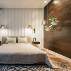 The space defining and leading visual element is the wooden cladding, with its green elements that is supplemented by the clean lights.