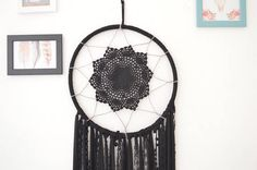 Catch all your peaceful dreams with this dramatic black dream catcher This stunning black dream catcher wall hanging is a beautiful statement of the bohemian style, Made of hoop, wrapped with trico ribbon, the center is hand crocheted with cotton thread, the bottom is decorated with satin ribbon, lace, trico and love.   CUSTOM ORDERS: Want a smaller or larger size? Or a different style that represents you or a loved one? Just send me a convo.  The Native Americans believe that in the night…