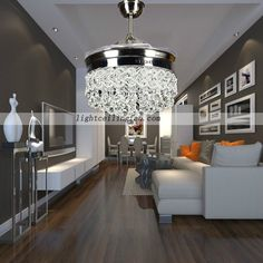 The Retractable Crystal LED Ceiling Fan functions both as a light pendant and a ceiling fan. The unit effectively hides the blades from view when not in Elegant Ceiling Fan, High Ceiling Lighting, Ceiling Fans Without Lights, Ceiling Fan With Remote, Led Ceiling, Fancy Ceiling Fan, Decorative Ceiling Fans, Living Room Ceiling Fan, Home Ceiling