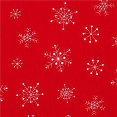 red designer Christmas fabric with white snowflakes