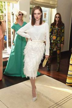 June 2015: Model Coco Rocha paired her Christian Siriano feathered skirt and sweater combo with an open weave pump by the designer at his resort presentation.