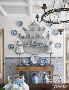 The owner's collection of blue-and-white porcelain inspired the dining room's palette. The lampshades are in a Robert Kime fabric. The Portuguese tile is from Solar Antique Tiles. The walls are in Clunch by Farrow & Ball. Home Interior, Interior Design, Veranda Magazine, Design Apartment, Antique Tiles, Antique Wood, Enchanted Home, Creation Deco, Blue And White China