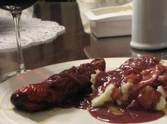 Bangers and Mash With Onion Gravy...OMG i am so ga-ga over this delicious dish. I love it. Click for recipe :)