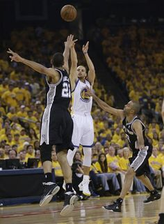 Stephen Curry shoots over Tim Duncan!
