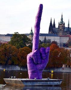 In the BBCreported that the artist erected a giant purple statue of an elongated middle finger aimed at the Prague residence of Czech president Milos Zeman. Budapest, Urban Graffiti, Prague Czech Republic, Heart Of Europe, Land Art, Ancient Art, Public Art, Urban Art, Installation Art