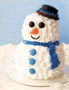 Bring out the child in everyone with an enchanting snowman, made with chocolate-mint cake and melt-in-your-mouth icing. Candy eyes and a cho...