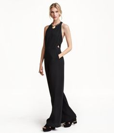 Sleeveless jumpsuit in slightly textured woven fabric. Narrow cut at top, cut-out sections at sides, and seam at waist. Side pockets and wide, straight legs. Partly open at back with concealed zip.