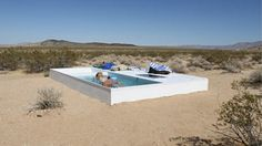 It's not a mirage - it's art! The secret swimming pool hidden in the Mojave Desert . but travellers need to crack GPS coordinates to find it - Cooling down: Once they have finally found it, explorers enjoy the hidden pool, located in the Mojave Desert. Death Valley, Pool Piscina, Oasis, Digital Life, Hidden Pool, Moderne Pools, Mojave Desert, Desert Map, Outdoor Furniture Sets