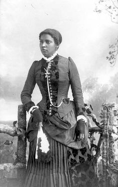 Woman with a fan made of feathers by Black History Album, via Flickr  Portraits of African Americans from the Alvan S. Harper Collection (1884-1910)