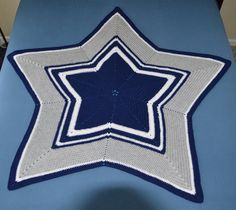 Handmade Dallas Cowboy's Inspired Star Afghan. Crocheted in navy, white and grey.