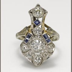 An art deco diamond, synthetic sapphire and platinum-topped 14k white gold ring, circa 1930