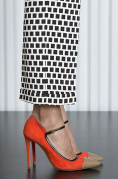 Stunning orange shoes with fawn toe-cap, and black-and-white geometric cuffed pants. Etro